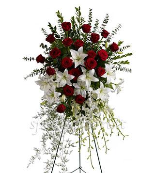 cuscino-funebre-di-gigli-bianchi-e-rose-rosse